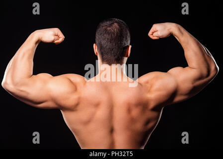 Men's rear double biceps pose. - Stock Photo
