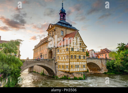 BAMBERG, GERMANY - JUNE 19: Tourists at the historic town hall in Bamberg, Germany on June 19, 2018. The famous town hall was built in the 14th centur - Stock Photo