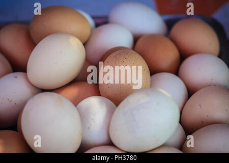 Close up white and brown chicken eggs background. Boiled or grilled eggs for sale on the street in Bangkok, Thailand. - Stock Photo