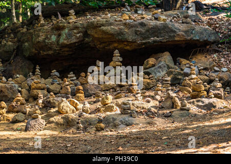 Piles of rocks left by hikers in Bohemian Switzerland, also known as Czech Switzerland, is a picturesque region in the north-western Czech Republic. - Stock Photo