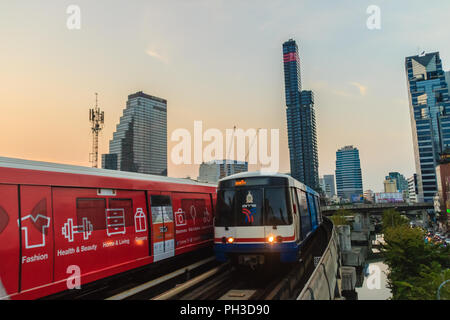 Bangkok, Thailand - March 8, 2017: The Bangkok Mass Transit System, BTS or Skytrain, Silom line, driving through the city center coming from/to Chong  - Stock Photo