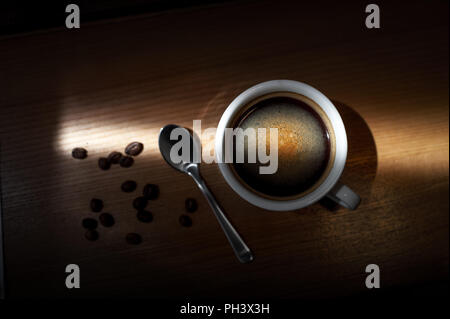 Hot coffee cappuccino cup with milk foam on wood table background - Stock Photo