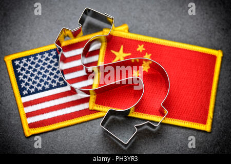 Dollar sign on flags of the USA and China, tariff war - Stock Photo