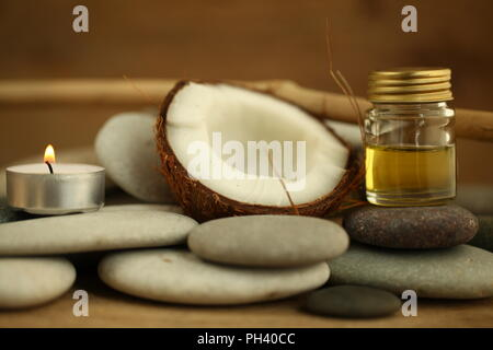 coconut oil for massage pebble candle - Stock Photo