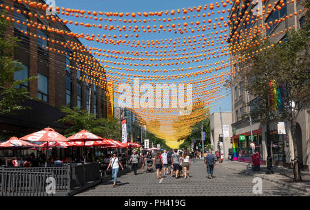 Decorations and no traffic in Gay Village on Rue Sainte-Catherine in Montreal, QC, Canada - Stock Photo