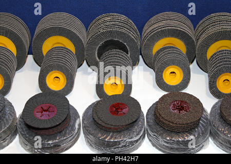 New sanding discs in various dimensions and grades - Stock Photo