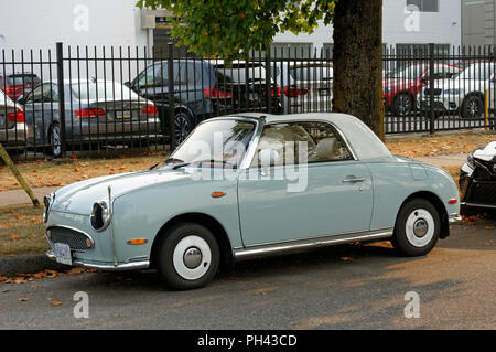 Nissan Figaro 2+2 retro-styled fixed profile convertible car parked on a street in Vancouver, BC, Canada - Stock Photo
