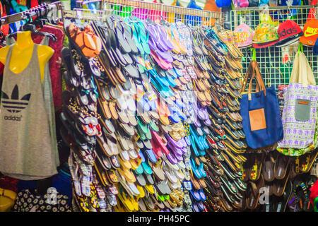 Bangkok, Thailand - March 2, 2017:  Colorful flip flop sandals in store at Khao San Road night market, Bangkok, Thailand. - Stock Photo