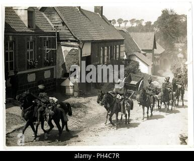 Indian cavalry marching through a French village [near Fenges]. Photographer H. D. Girdwood. . - Stock Photo