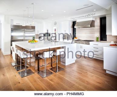 White kitchen with hardwood floor - Stock Photo