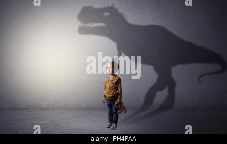 I m dreaming about dinosaurus concept with cute little boy in an empty room  - Stock Photo