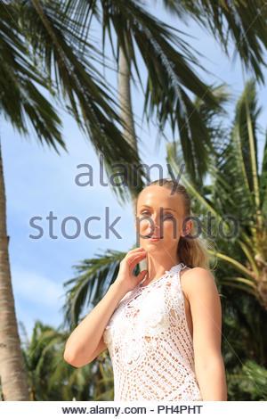 Young woman wearing white crochet - Stock Photo