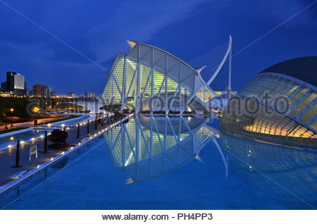 City of Arts and Sciences - Prince Philip Science Musem and L'Hemisfèric dusk illumination. Designed by Santiago Calatrava in Valencia Spain Europe. - Stock Photo