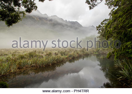 Fog over Lake Wakatipu in New Zealand - Stock Photo