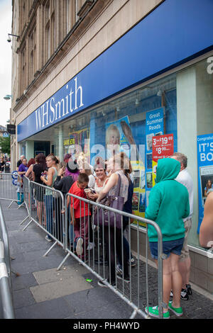 People queueing to meet magician Dynamo appearing at WH Smith in Sheffield, South Yorkshire, England - Stock Photo