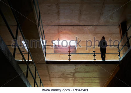 Young woman on ESO Hotel balcony at Paranal Observatory - Stock Photo