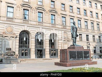 The historic Cleveland Board of Education Building, now a Drury Hotel, in downtown Cleveland has a  statue of Abraham Lincoln outside its doors. - Stock Photo