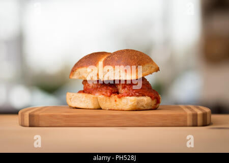 A homemade meatball sandwich on a nice brioche bun. - Stock Photo