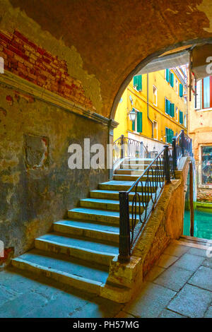 Gateway and small bridge over canal in Venice, Italy - Stock Photo