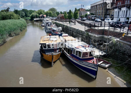 boats moored on river stour at the quay sandwich kent england UKwarm weather - Stock Photo