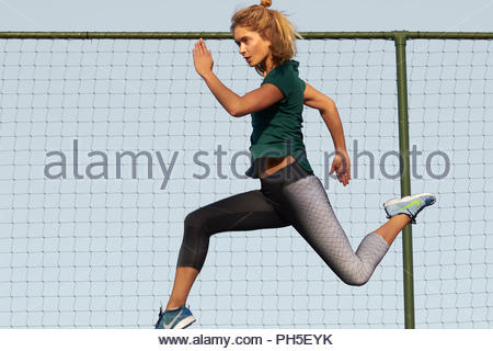 Young woman in tights exercising - Stock Photo