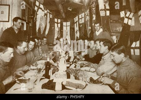 'Captain Scott's Last Birthday Dinner', 6 Jun 1911, (1913). Celebrating expedition leader Robert F Scott's 43rd birthday, left to right: Atkinson, Meares, Cherry-Garrard, Oates (standing), Taylor, Nelson, Evans, Scott, Wilson, Simpson, Bowers, Gran (standing), Wright, Debenham, Day. The final expedition of British Antarctic explorer Captain Robert Falcon Scott (1868-1912) left London on 1 June 1910 bound for the South Pole. The Terra Nova Expedition, officially the British Antarctic Expedition (1910-1913), included a geologist, a zoologist, a surgeon, a photographer, an engineer, a ski expert, - Stock Photo