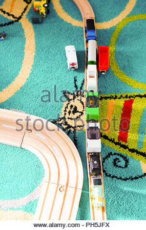 Toy locomotive with wagon on a wooden tack from aerial perspective - Stock Photo