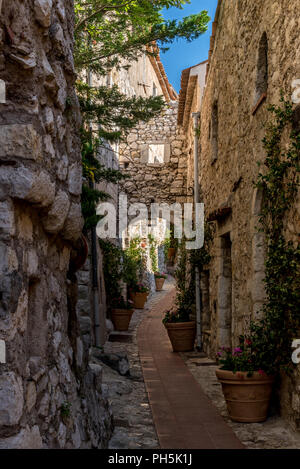 Narrow cobbled streets and old stone buildings in the village of Eze on the Cote d'Azur in the South of France - Stock Photo