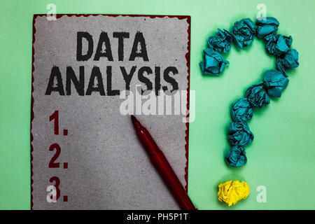 Handwriting text writing Data Analysis. Concept meaning Translate numbers to Analytical Conclusion Forecasting Gray paper marker crumpled papers formi - Stock Photo