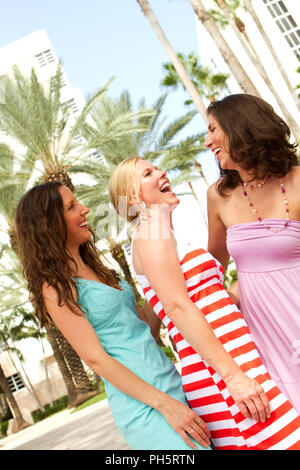 Friends hanging out at the beach. - Stock Photo