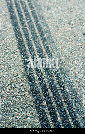 trail deceleration of automobile tires on asphalt - Stock Photo