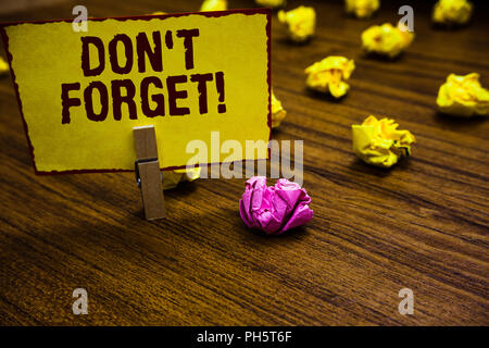 Writing note showing Don t not Forget. Business photo showcasing Know by Heart Think Back Fix in the Mind Refresh Memory Clothespin holding yellow pap - Stock Photo