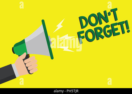 Text sign showing Don t not Forget. Conceptual photo Know by Heart Think Back Fix in the Mind Refresh Memory Man holding megaphone loudspeaker yellow  - Stock Photo