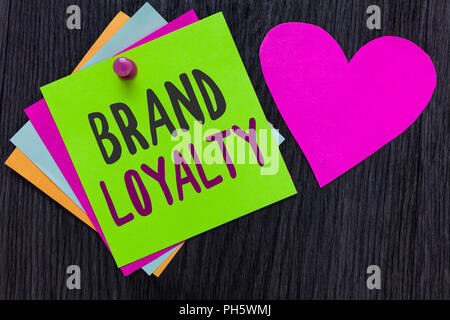 Text sign showing Brand Loyalty. Conceptual photo Repeat Purchase Ambassador Patronage Favorite Trusted Papers Romantic lovely message Heart Good feel - Stock Photo