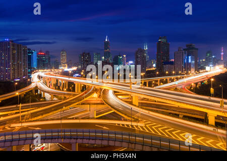 Shanghai elevated road junction and interchange overpass at night in Shanghai, China - Stock Photo