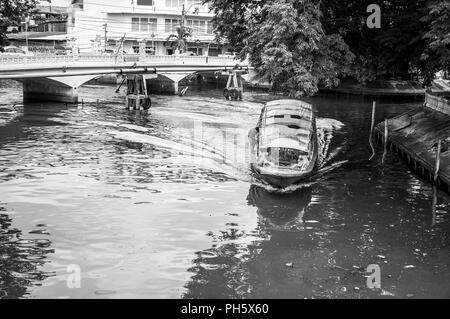 Thailand boat canal transportation moving for U-Turn at the SanSarb canal, Bangkok, Thailand - Stock Photo