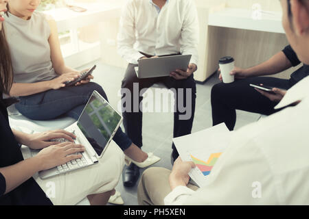 Casual busniess people meeting at modern office. Business team coworkers sharing business report document. - Stock Photo