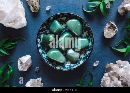 Green Aventurine and Quartz on Blue Table - Stock Photo