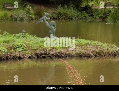 Lovely Mother and son at play statue - Stock Photo