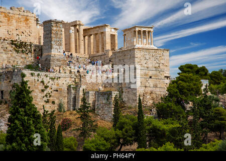 The Propylaea of the Acropolis of Athens with the temple of Athena Nike on the upper right side. Athens, Greece - Stock Photo