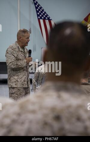 UNDISCLOSED LOCATION, MIDDLE EAST – U.S. Marine Corps Gen. Robert B. Neller, the Commandant of the Marine Corps, addresses Marines and Sailors from Special Purpose Marine Air-Ground Task Force, Crisis Response-Central Command June 26, 2018. Neller praised Marines for their unit's performance thus far and encouraged them to stay on the right path. - Stock Photo