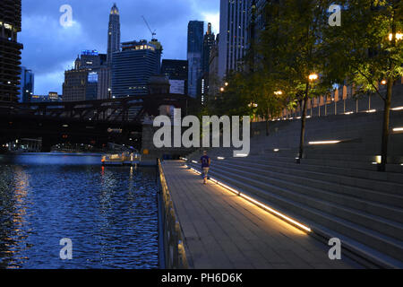 Lights along the Riverwalk in Chicago before the sun rises. - Stock Photo