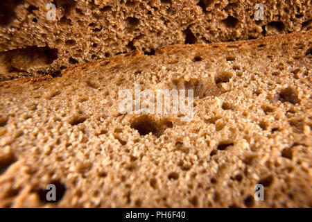 Fresh bread extreme close up. Macro textured view of bread slices - Stock Photo