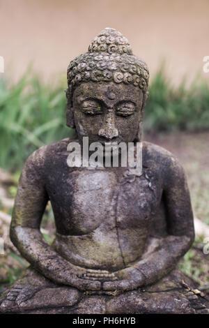 Old balinese deity statue - Stock Photo