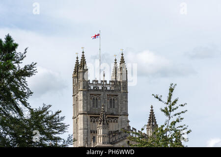 St Georges cross flag flying from the tower of  the Abbey Church of Saint Peter & Saint Paul (Bath Abbey) in the city of Bath viewed from the river - Stock Photo
