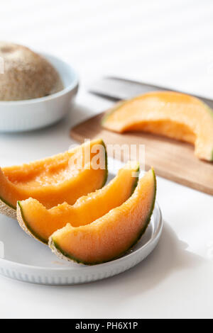 Fresh Cantaloupe sliced on plate - Stock Photo