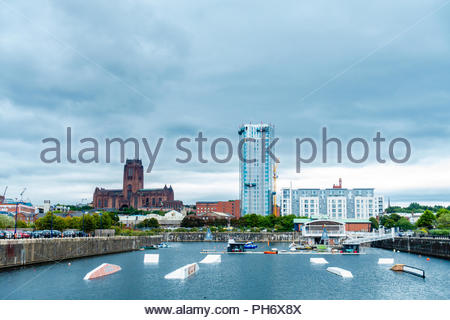 Liverpool Water Sports Centre training facility Queens Dock, Liverpool, showing new building regeneration & The Anglican Cathedral, Liverpool England - Stock Photo