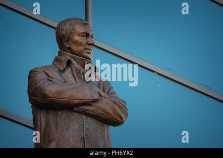 MANCHESTER, UK - MAY 19 2018: Sir Alex Ferguson Bronze statue in front of Alex Ferguson stand at Old Trafford stadium, the Home of Manchester United - Stock Photo