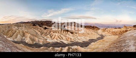 Panorama of Zabriskie Point in Death Valley just after sunrise. - Stock Photo