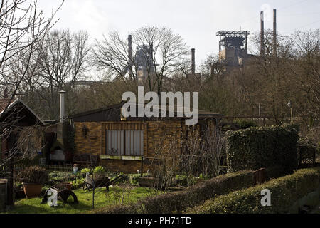 Allotment gardens, industry, Duisburg, Germany. - Stock Photo